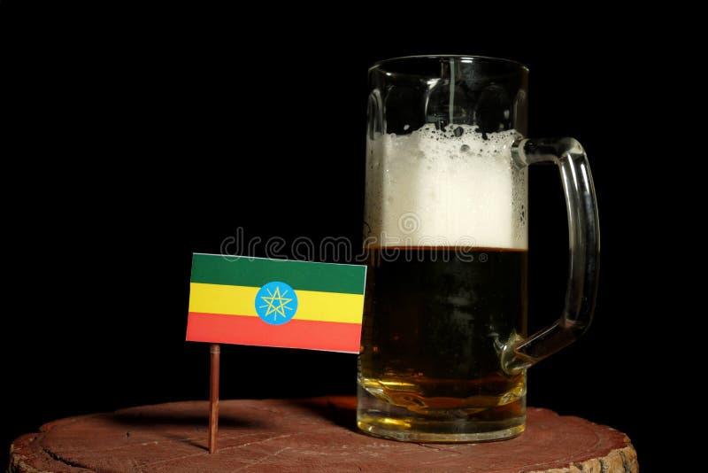 Ethiopian flag with beer mug isolated on black. Background royalty free stock image