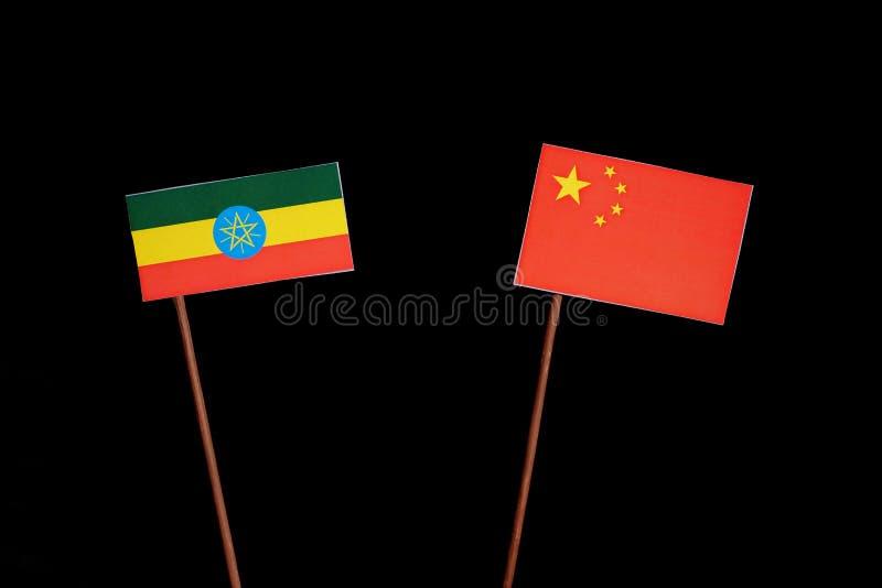 Ethiopian flag with Chinese flag isolated on black. Background stock photo