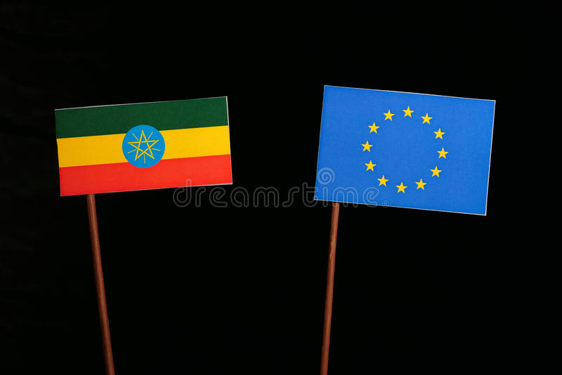 Ethiopian flag with European Union EU flag isolated on black. Background royalty free stock photos