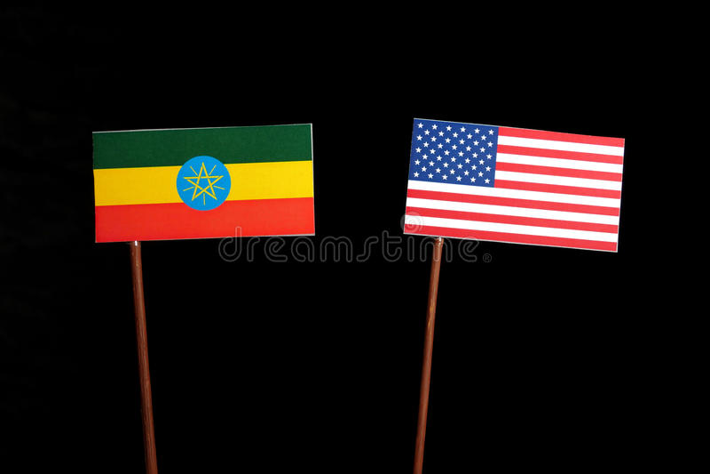 Ethiopian flag with USA flag isolated on black. Background stock images