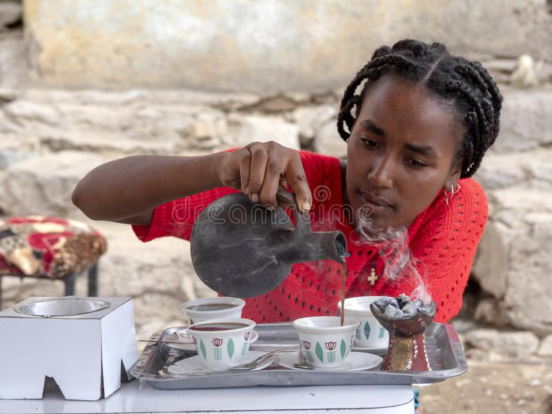 ETHIOPIA, APRIL 28th.2019, Ethiopian girl preparing traditional coffee, April 28th. 201,  Ethiopia stock images