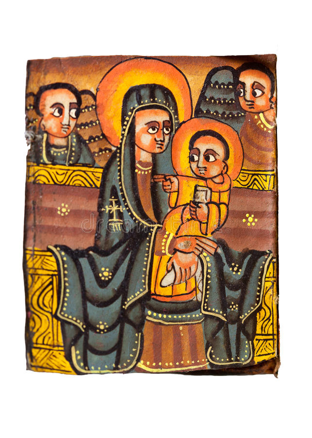 Ethiopian Holy Virgin Christ. Leaf from an Ethiopian manuscript representing the Holy Virgin and her Son, Jesus, in hodegetria (She Who shows the way) style royalty free stock image
