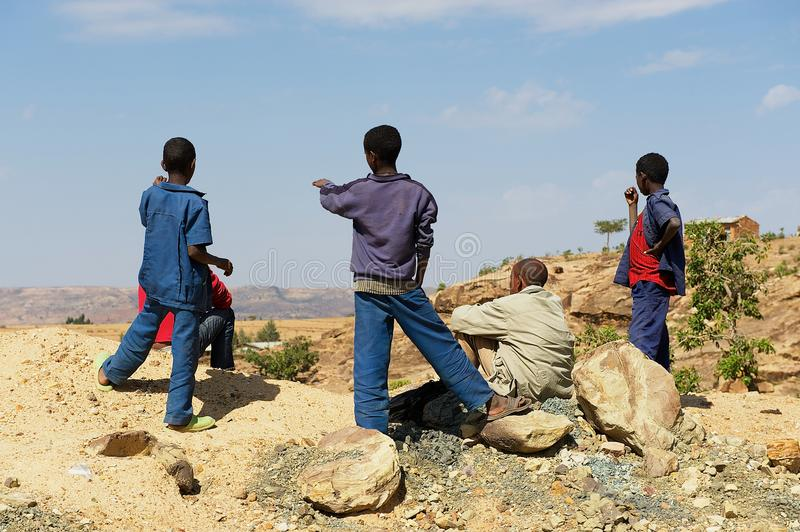 Ethiopian teenager boys enjoy the rural view to the Debre Damo monastery area from a viewpoint in Tigrai, Ethiopia. royalty free stock images