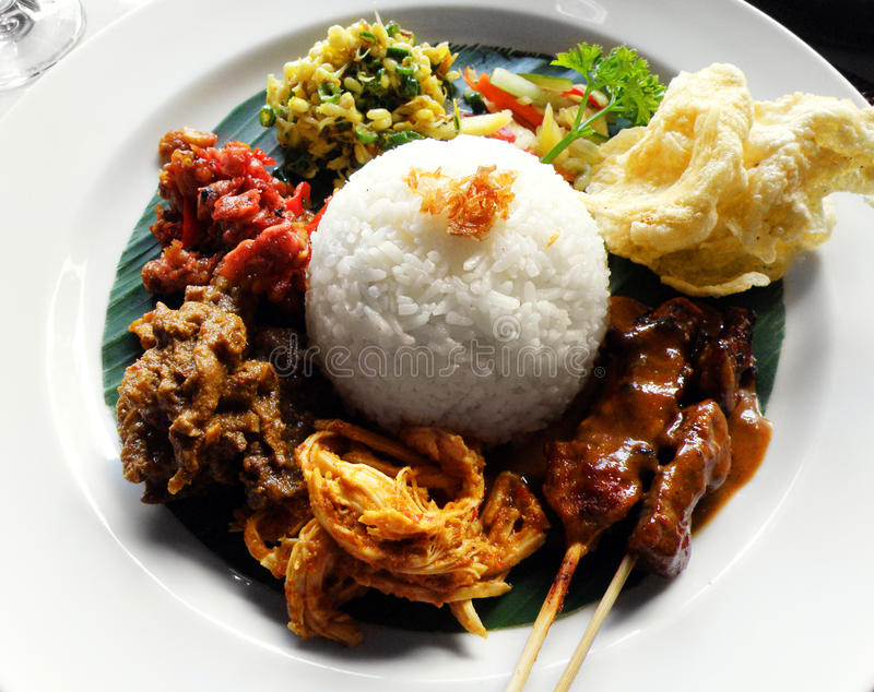 Ethnic asian food, nasi campur. A photograph of a traditional asian ethnic main course meal of Nasi Campur, or white rice served with many assorted local side royalty free stock photos