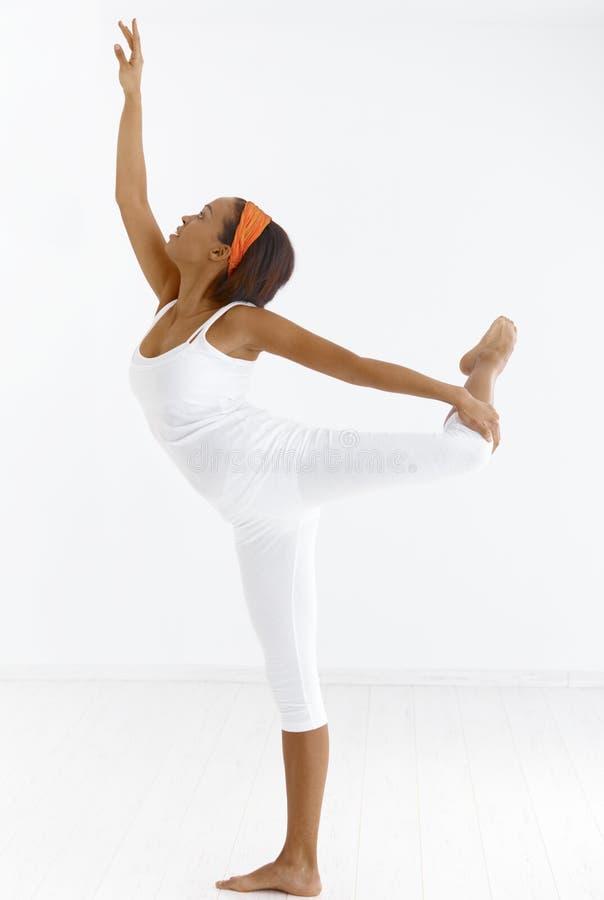 Ethnic ballet dancer. Portrait of pretty ethnic ballet dancer in pose in studio royalty free stock image