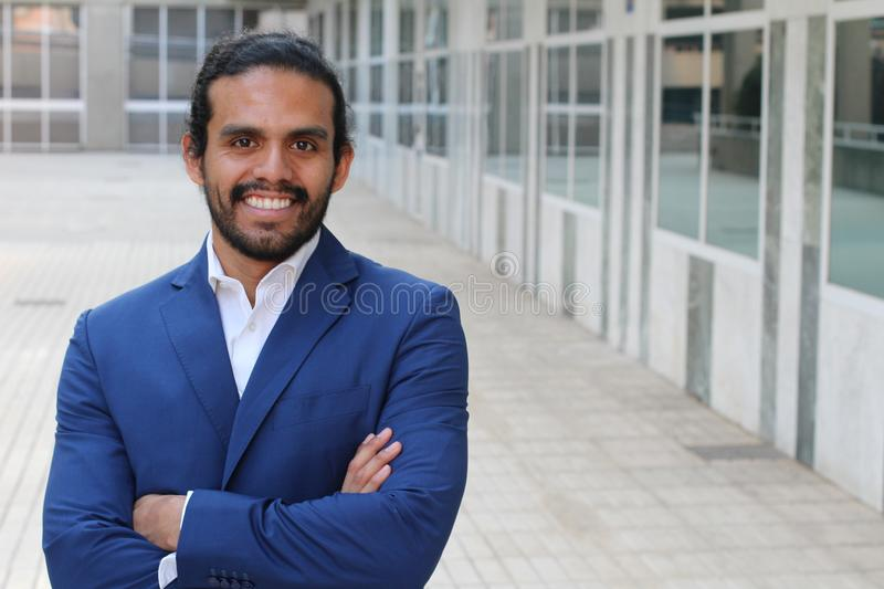 Ethnic business confident man posing with folded arms - Stock image with copy space royalty free stock photos