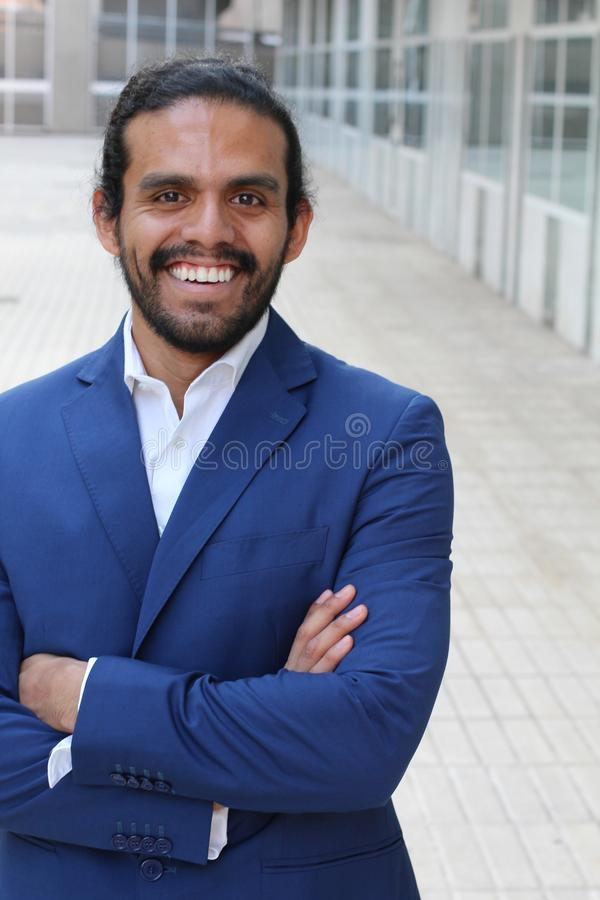 Ethnic business confident man posing with folded arms - Stock image.  stock photo