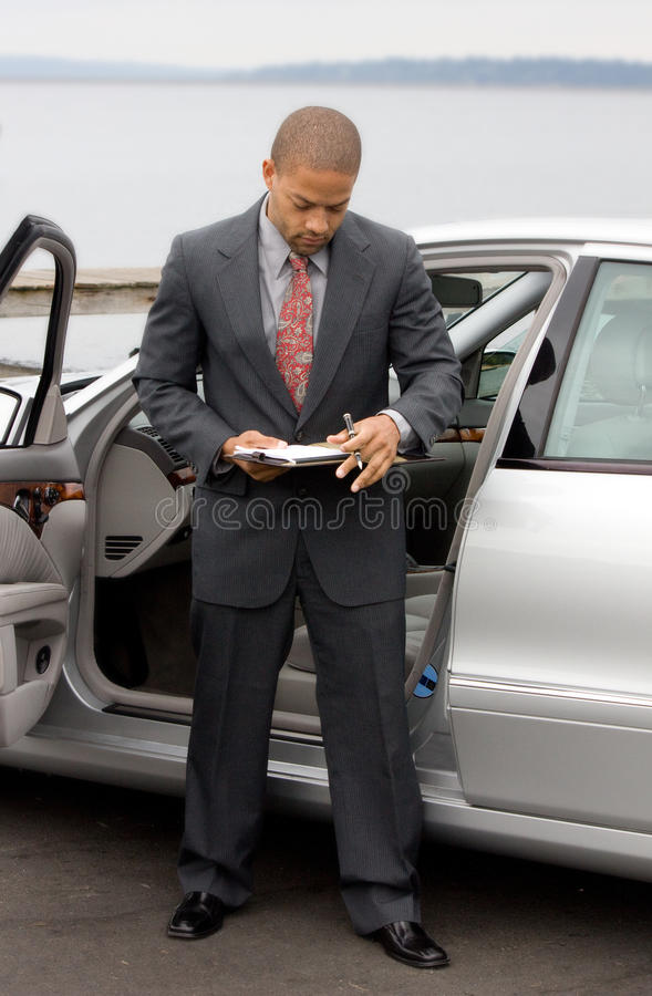 Ethnic Business Man with clipboard and pen royalty free stock photography