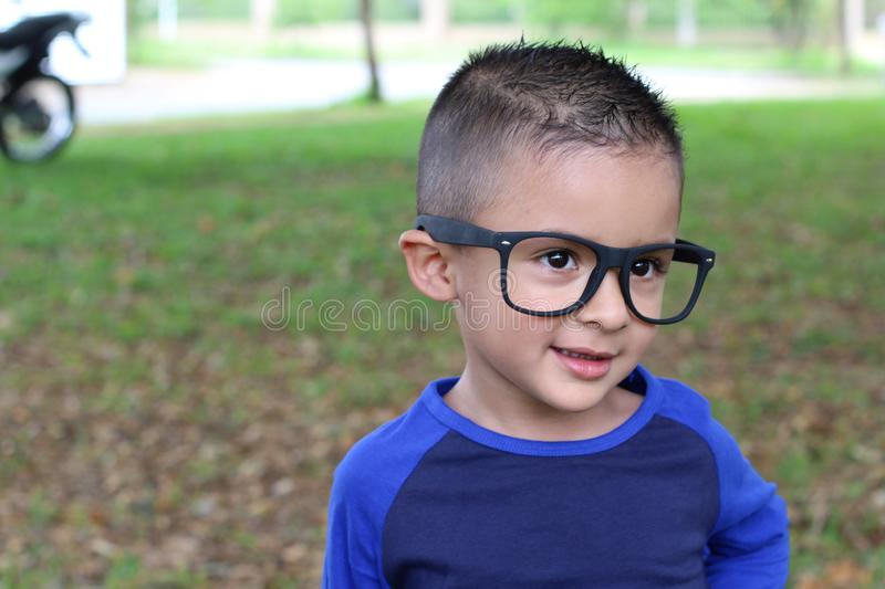 Ethnic child with glasses isolated stock photography