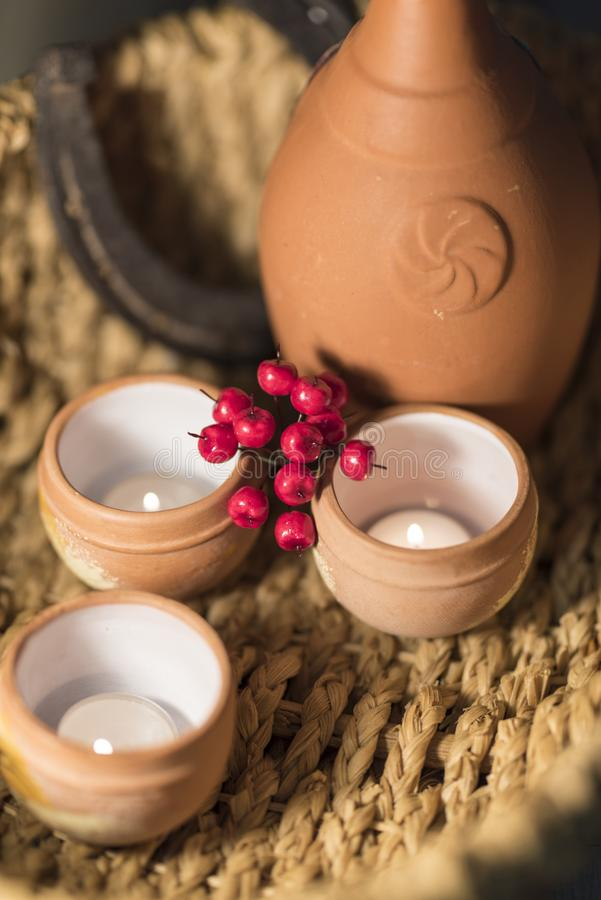 Ethnic Composition Pottery, Berries and Candles 2019 stock photography