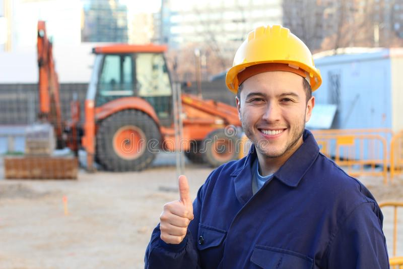 Ethnic construction worker giving a thumbs up stock images