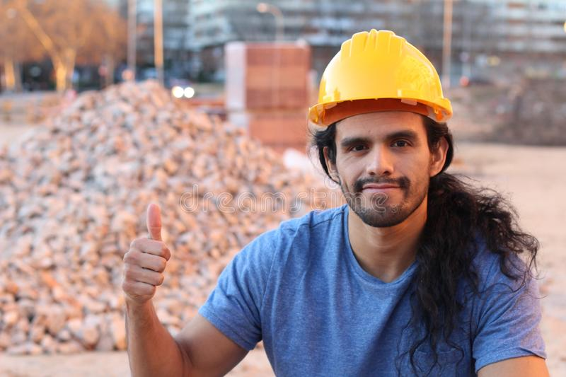 Ethnic construction worker in site stock photo