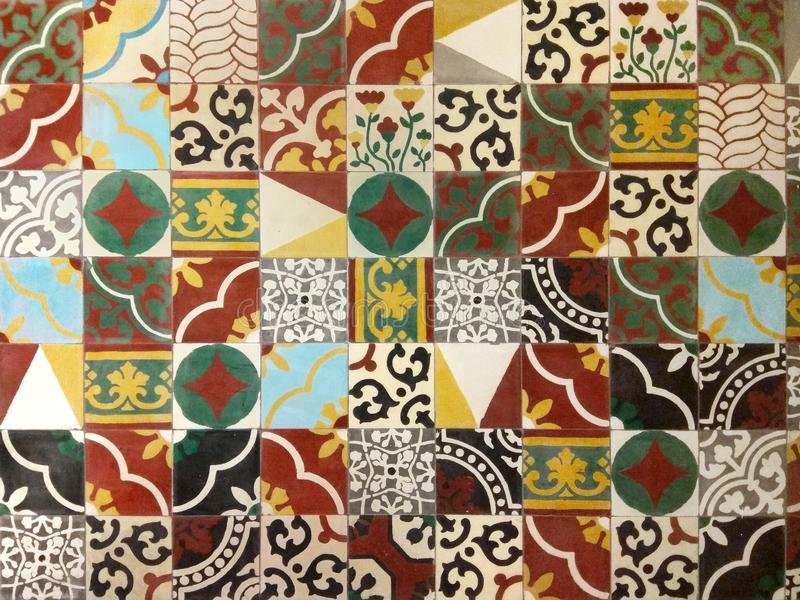 Ethnic Decor Tiles Wall. Ethnic decor tiles on old retro wall with many colours and pattern stock photo