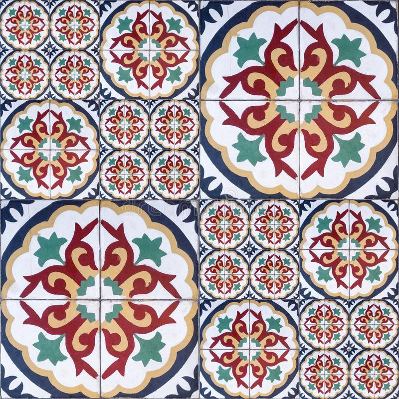 Ethnic decorative seamless pattern of red tiles with white ornaments that connect perfectly. The pattern tiles connect perfectly stock photo