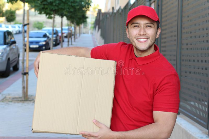 Ethnic delivery man at work royalty free stock images