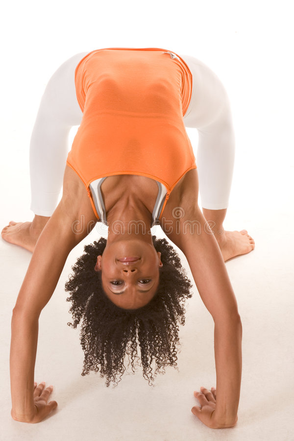 Ethnic female in sport clothes bridge exercise royalty free stock photography