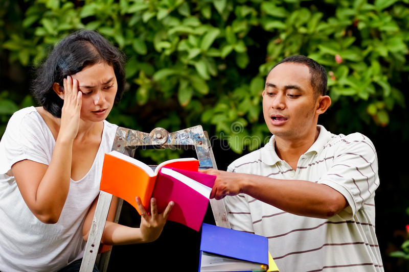 Download Ethnic Friends Discussing Literature Stock Image - Image: 24141351
