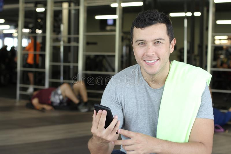 Ethnic guy using a fitness app stock image