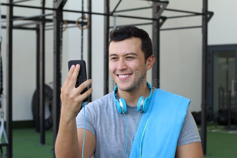 Ethnic guy using a fitness app stock photo