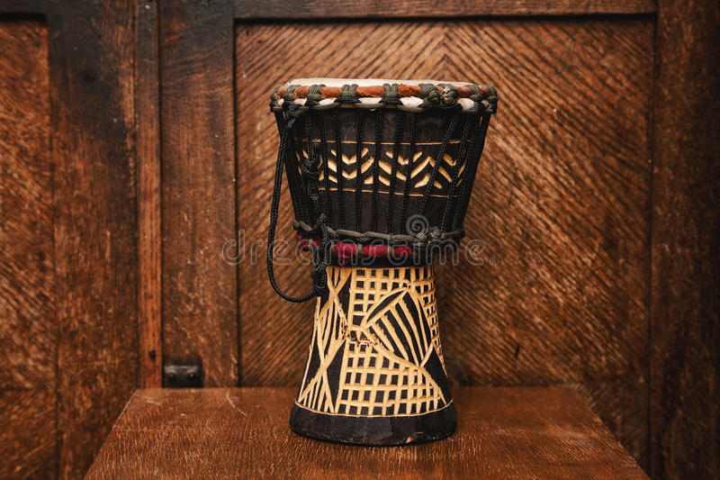 Ethnic hand drum Indian. Hand drum Indian on vintage wooden background stock photo