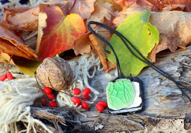 Ethnic handmade clay amulet stock photo