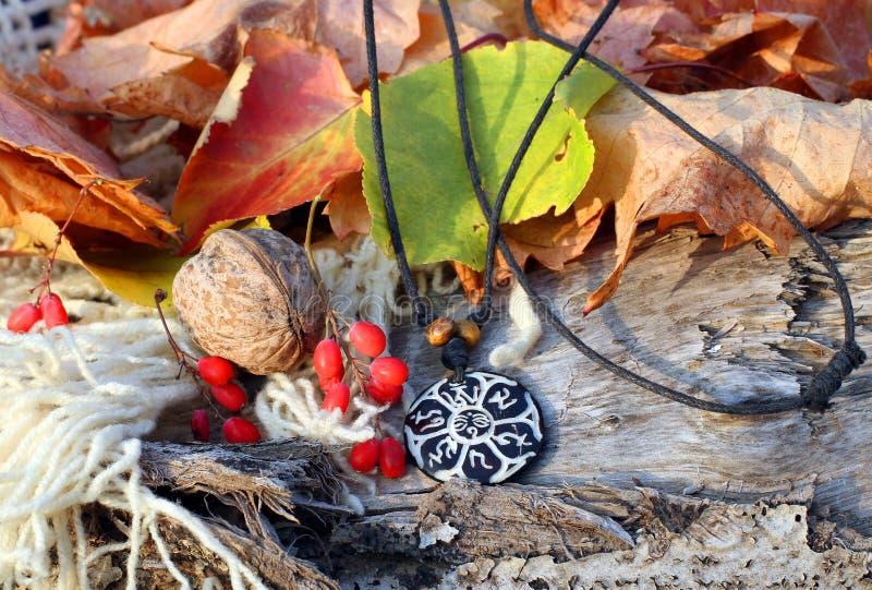 Ethnic handmade magic b&w clay amulet stock image