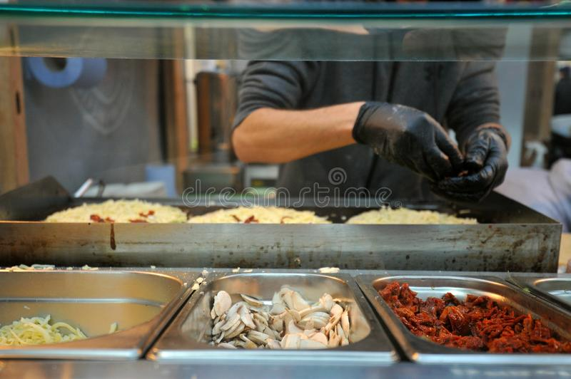 Ethnic Italian street food in Brick lane at a London Market royalty free stock images