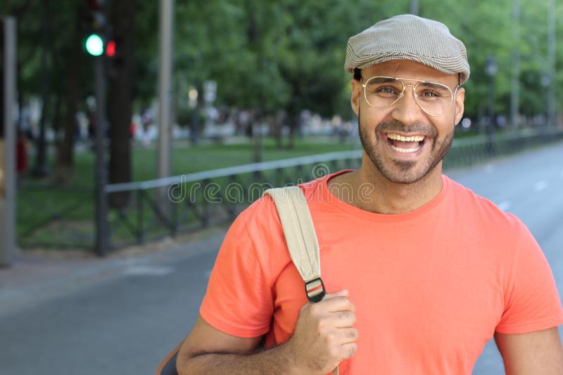 Ethnic man laughing out loud outdoors stock photography