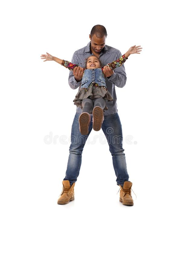 Download Ethnic Man Playing With Little Daughter Having Fun Stock Photo - Image of father, daughter: 25700798