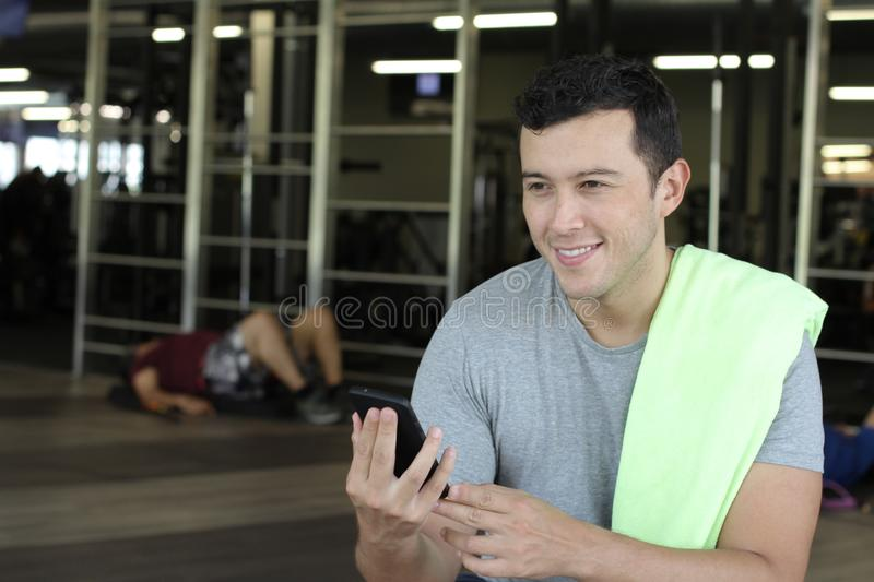 Ethnic man using fitness app with copy space royalty free stock photo