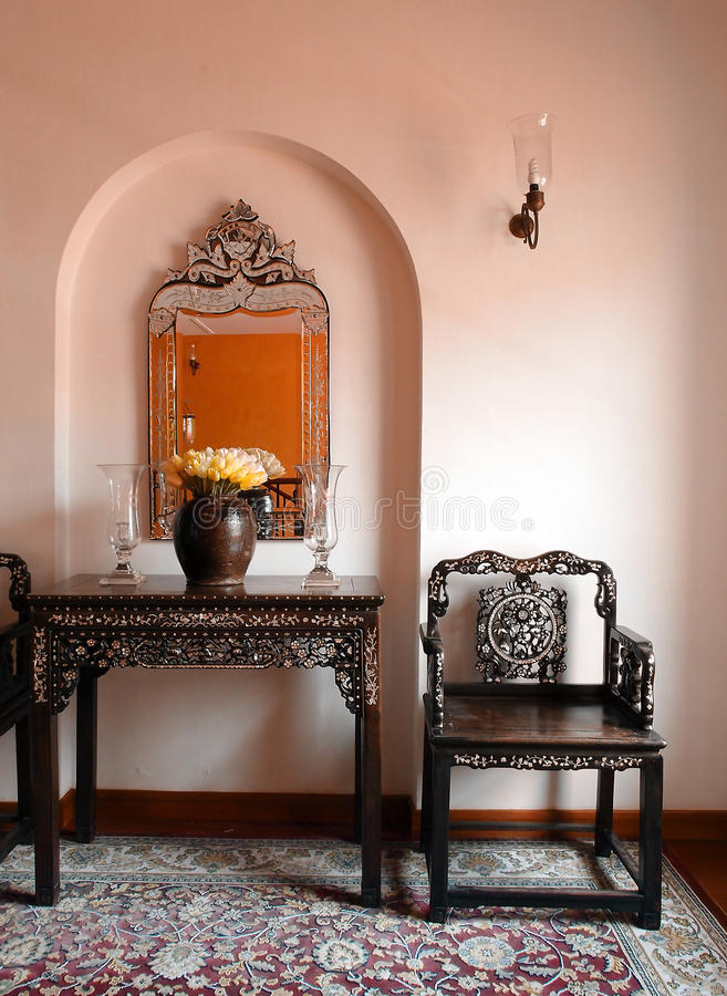 Ethnic Straits chinese malay decor. A photograph showing some beautiful antique furniture and decorative ornamental items in the home of a traditional peranakan stock photo