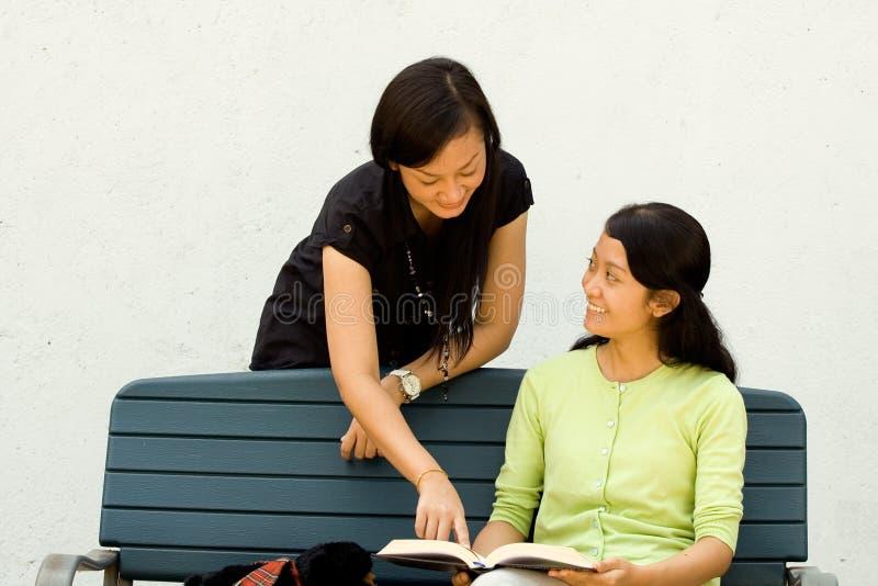 Ethnic students studying together stock photo