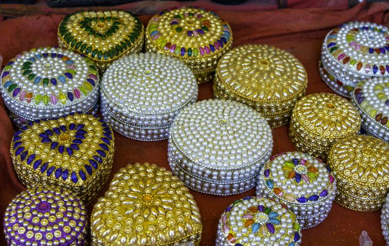 Ethnic style jewellary box made from pearl of different colors stock image