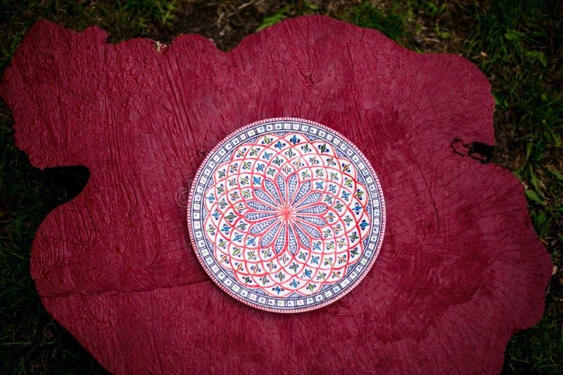 Ethnic Uzbek plate on wood royalty free stock photo