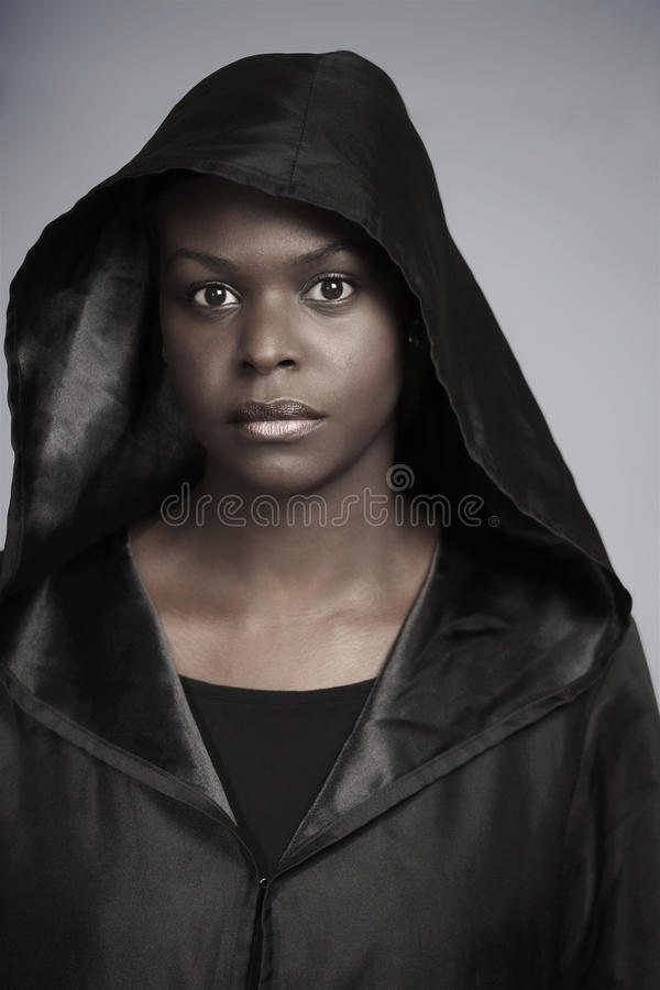 Ethnic woman in black hood royalty free stock photo