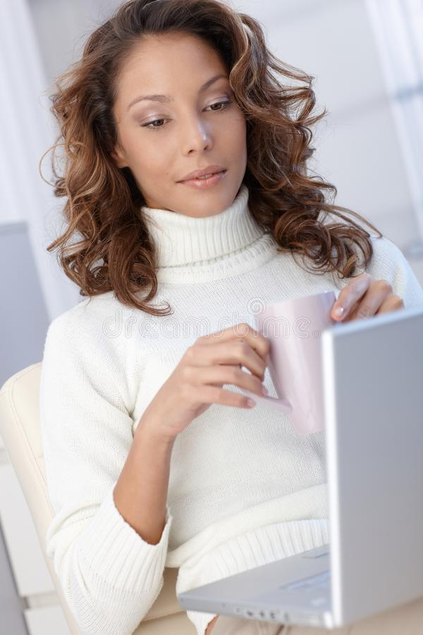 Download Ethnic Woman With Computer A Home Stock Photo - Image: 28890858