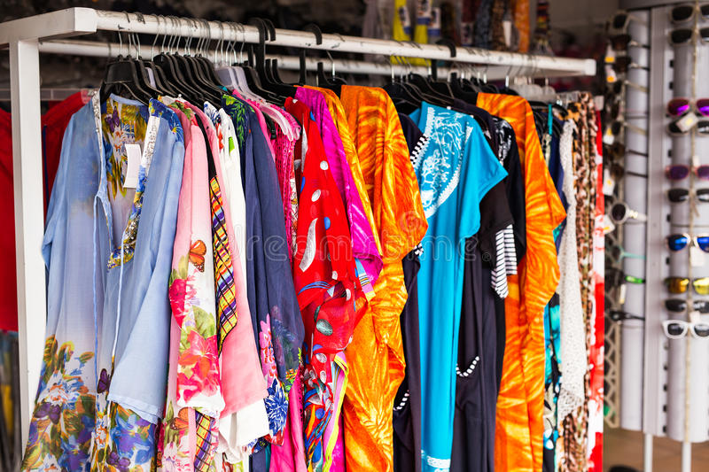Ethnic women`s clothes on hangers stock photography