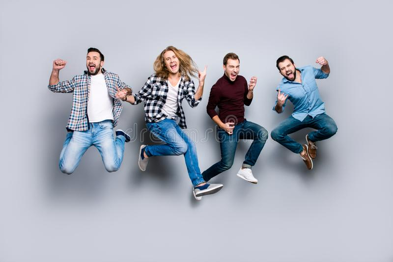 Ethnicity diversity careless freedom people chill hang-out figure playful funny showing symbols concept. Four excited cheerful ac. Tive carefree men jumping up stock photos