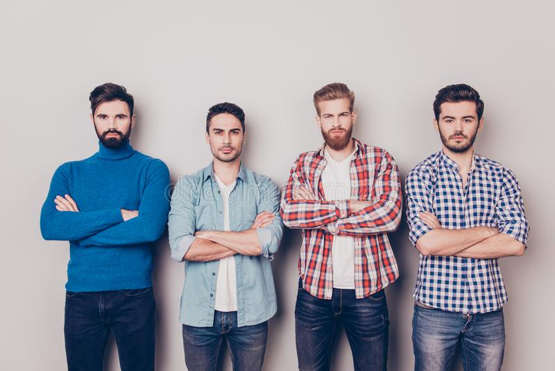 Ethnicity, multicultural diversity. Four serious harsh men are s royalty free stock photography