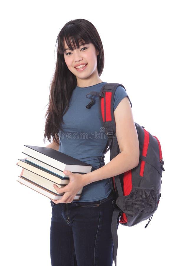 Ethnisches Studentmädchen mit Ausbildungsbüchern lizenzfreie stockbilder