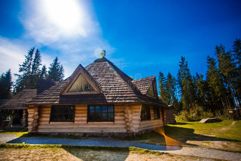 Ethno Old Wooden house in mountains forest village. house made of natural materials. Old deserted wooden house in summer forest stock image
