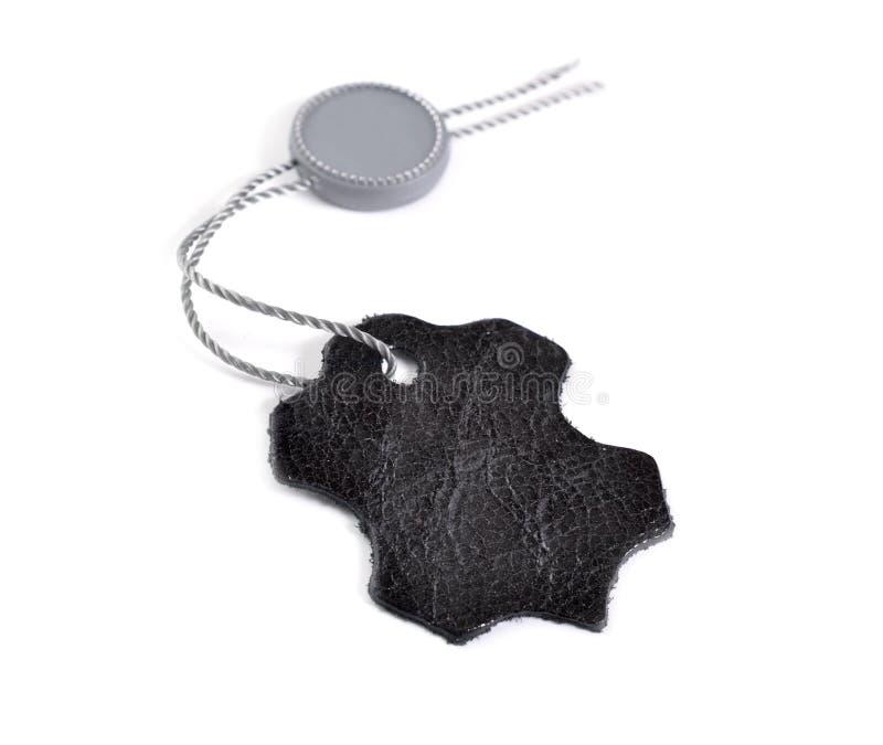 Etichetta di cuoio nera dell'etichetta isolata su fondo bianco fotografia stock libera da diritti