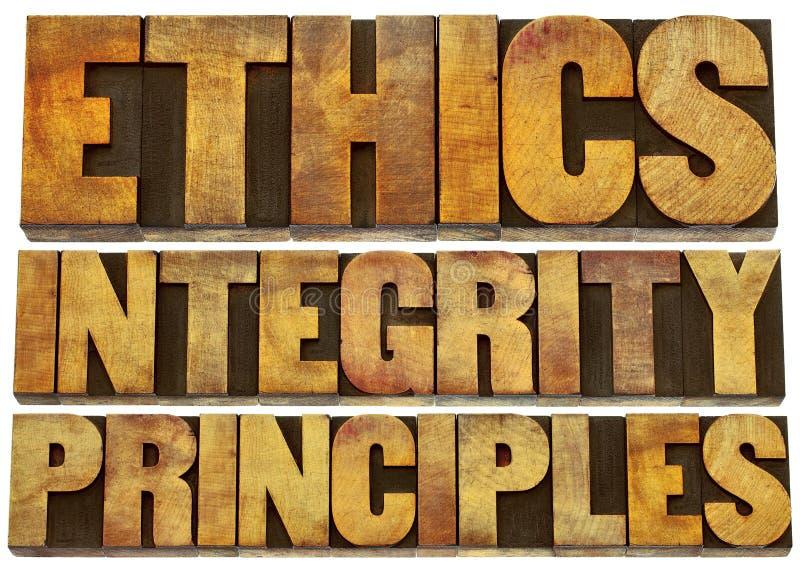 Etik, fullständighet och principer i wood typ royaltyfri foto