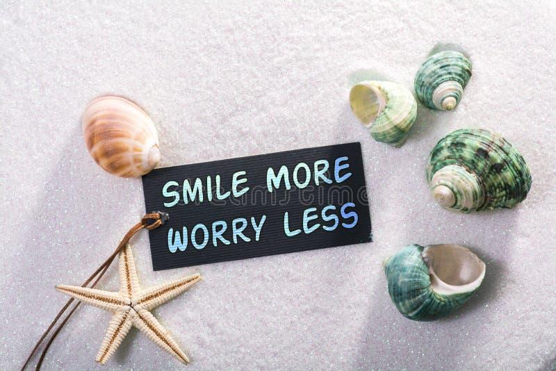 Etiket met glimlach meer zorg minder royalty-vrije stock fotografie