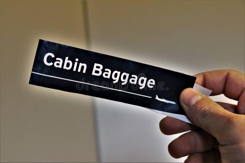 Etikett för kabinbagage Begrepp av loppet arkivfoton