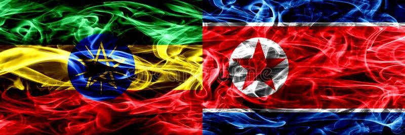 Etiopia vs korea północna, Koreańskie kolorowe dymne flagi umieszczająca strona strona - obok - zdjęcie stock