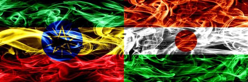 Etiopia vs Niger, Nigeryjskie kolorowe dymne flagi umieszczająca strona strona - obok - fotografia royalty free