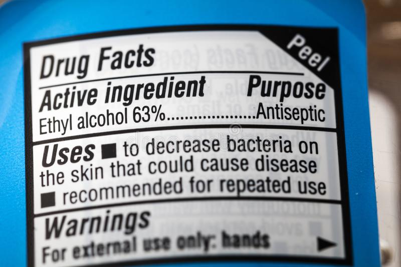 Etiqueta antiséptica de los hechos amonestadores del alcohol etílico de la droga imagenes de archivo