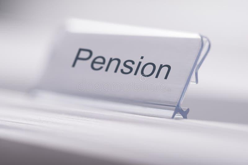 Etiqueta da pensão na tabela foto de stock