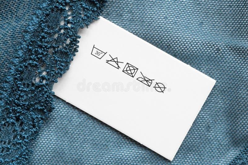 Etiqueta da roupa do cuidado imagem de stock royalty free